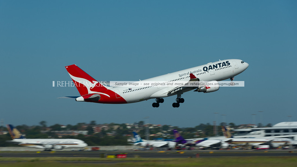 Qantas A330-200 Airbus takes off from Sydney airport, with Singapore Airlines A380 and Boeing 777, Thai Airbus A340 and Air New Zealand Boeing 767 in the background.