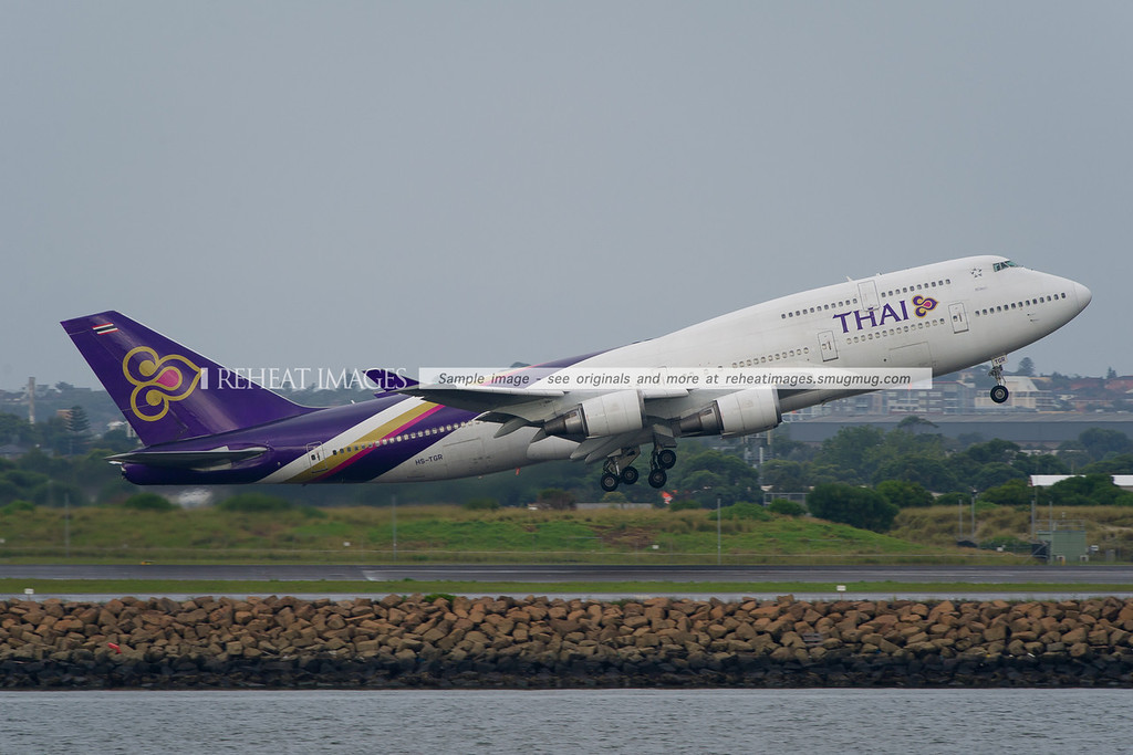 A Thai Boeing 747-4D7 lifts off from runway 16 right at Sydney airport.