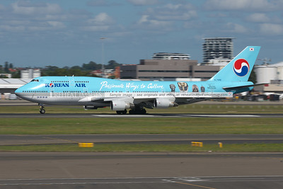 This Korean Air Boeing 747-400 wears decals promoting The British Museum - Passionate Wings to Culture. It has started its takeoff roll.