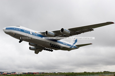 A Volga Dnepr Antonov AN124-100 on approach to land at Sydney airport. The massive cargo plane is seen here about to pass over Qantas Drive. Some cars even pulled over to watch it land.