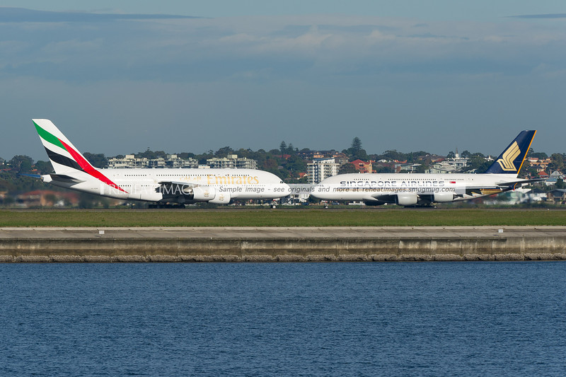 An Emirates Airbus A380-861 (powered by Engine Alliance GP7200 engines) comes face-to-face with its Rolls-Royce Trent 900 powered A380-841 sibling from rival Singapore Airlines. The Emirates plane is departing Sydney on runway 34 left. The Singapore plane was taxiing out to runway 34 left. Sydney airport is currently served by A380 aircraft from Singapore Airlines, Emirates and Qantas.