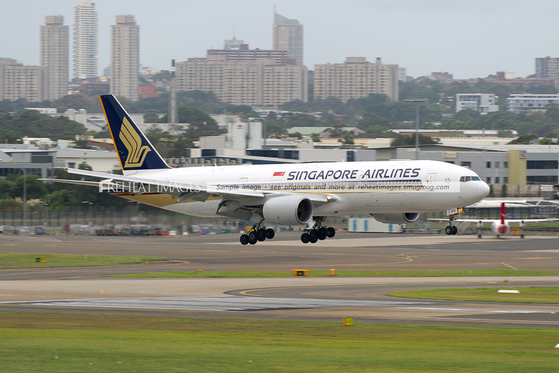 A Singapore Airlines Boeing 777-212/ER arrives at Sydney airport on runway 16 right.