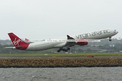Virgin Atlantic A340-600 G-VEIL leaves Sydney in the new colours.