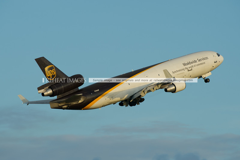 Impressive steep climb from runway 16 right at Sydney airport for this UPS McDonnell-Douglas MD-11F.