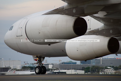 Adagold's Airbus A340-300 CS-TQM and two of its  four CFM International engines.