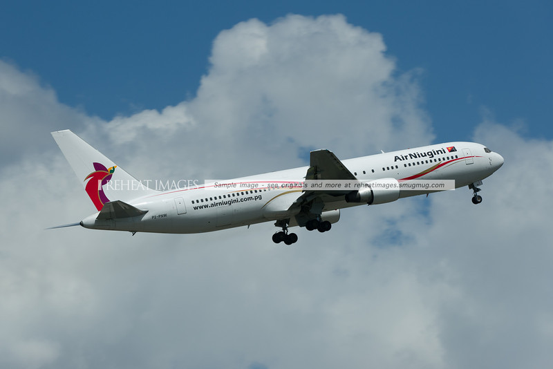 An Air Niugini Boeing 767 takes off from Sydney airport.