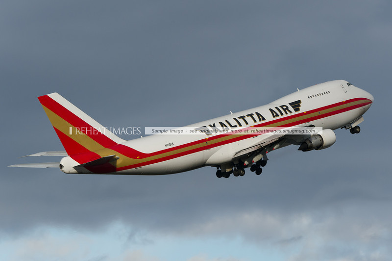 A Connie (Kalitta) Boeing 747-212BF departs Sydney airport. This Pratt & Whitney engined classic B747 is a relatively unusual sight in Sydney. This plane first flew in 1980 and was originally delivered to Singapore Airlines as 9V-SQL.