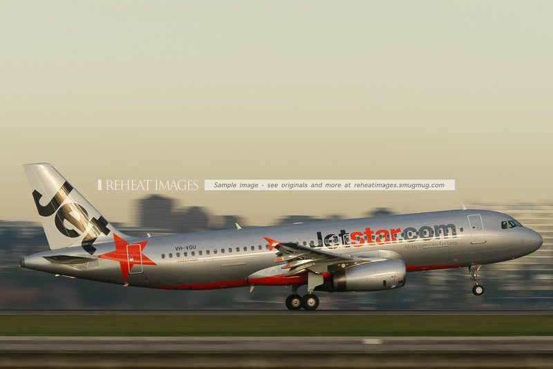 A Jetstar Airbus A320-200 takes off from runway 34 right at Sydney airport.
