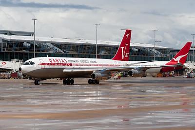 John Travolta arrives at the Qantas 90th anniversary celebrations in Sydney with his 1964 Qantas Boeing 707-138B.
