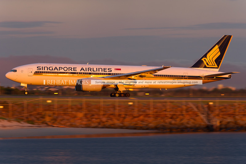 Singapore Airlines Boeing 777-212/ER takes off from Sydney airport in the evening sun light.
