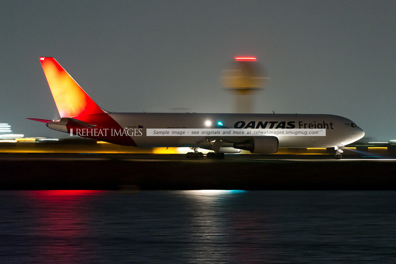 The Qantas Freight (Express Freighters Australia) Boeing 767-381F/ER taxiing out to runway 34 left at Sydney airport under the cover of darkness.