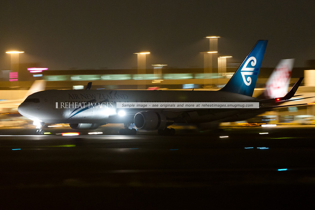 An Air New Zealand Boeing 767-319/ER arrives at Sydney airport at night.