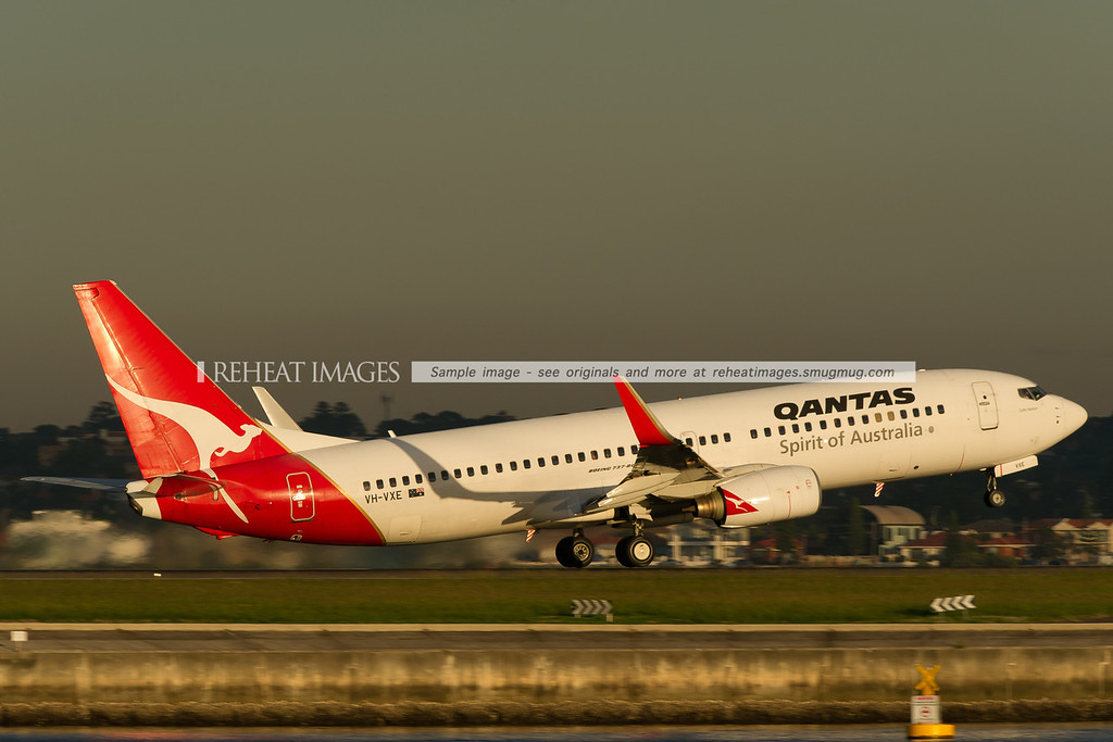 A Qantas Boeing 737-838 takes off from Sydney airport runway 34 right. These planes have a small and very private 12 passenger business class section at the front. It is certainly a nice way of traveling between major cities in Australia.
