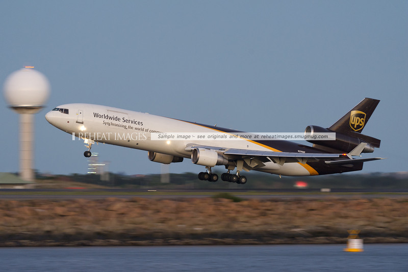 A UPS McDonnell-Douglas MD-11F aircraft takes off from runway 34 left at Sydney airport.
