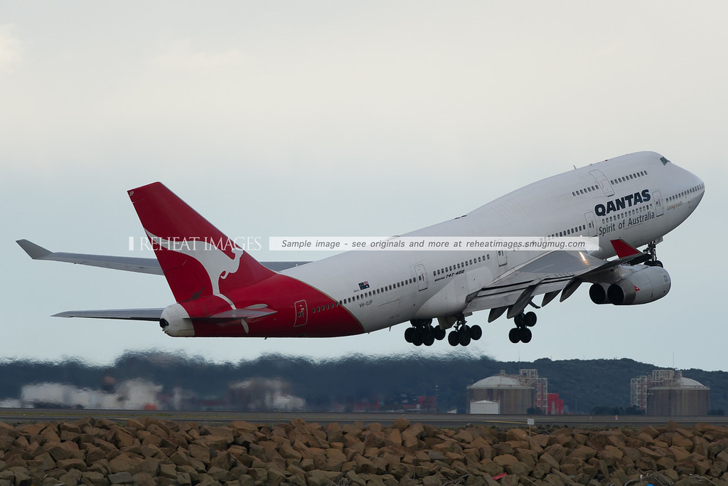 A Qantas B747-438 leaves Sydney airport.