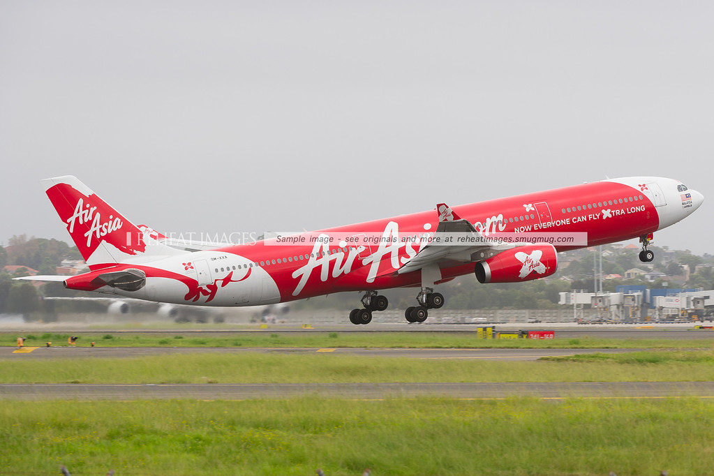 Air Asia X now flies in and out of Sydney. 9M-XXA is seen here departing Sydney.