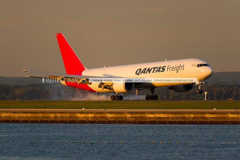 A Qantas Freight (Express Freighters Australia) Boeing 767-381F/ER lands at Sydney airport on runway 34 right.