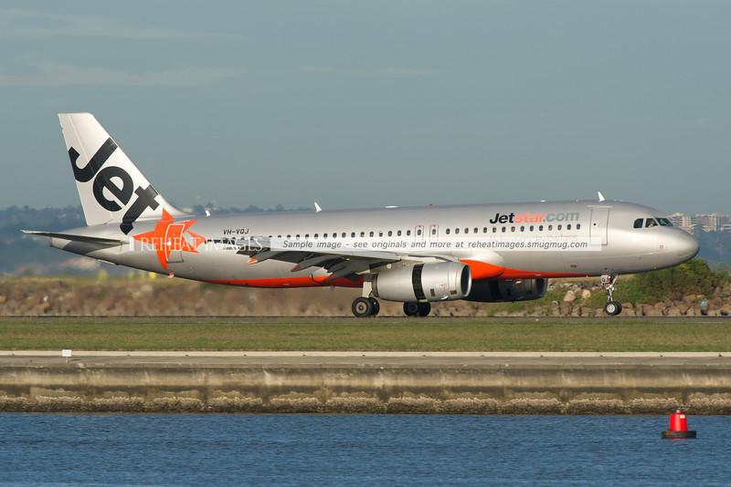 A Jetstar Airbus A320-200 arrives at Sydney airport on runway 34 right.