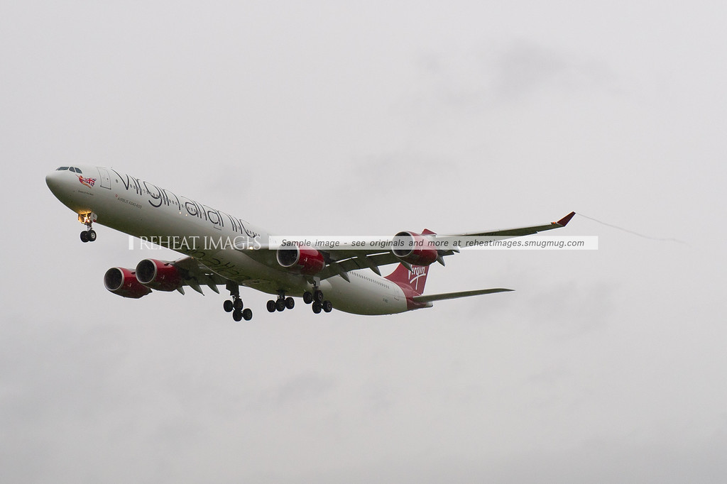 Virgin Atlantic A340-600 G-VEIL landing in Sydney wearing the new colours. VS200 is the flight, it was delayed by nearly 1 hour, but the lovely new colour scheme is worth it.