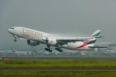 A6-EFF Emirates SkyCargo B777-F1H leaves Sydney as EK9825 in heavy fog.