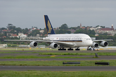 A Singapore Airlines Airbus A380-841 is being towed at Sydney airport.