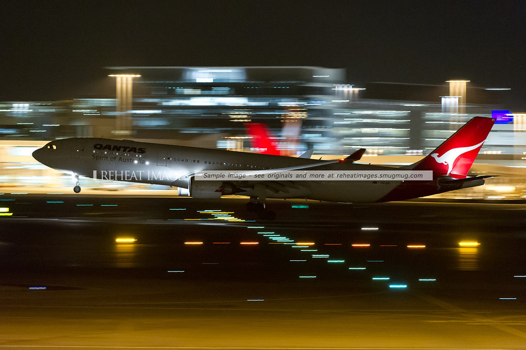 A Qantas A330-300 Airbus arrives in Sydney at night.