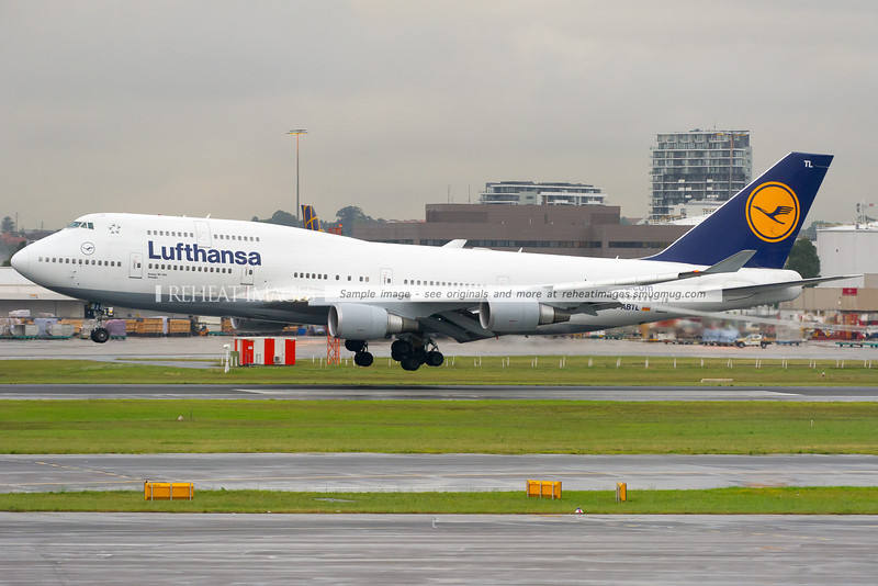 "A Lufthansa Boeing 747-430 D-ABTL named ""Dresden"" lands at Sydney Airport on runway 16 right in rainy conditions. The plane was carrying the famous Berliner Philharmoniker orchestra."