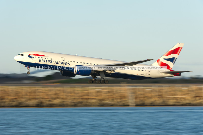 A British Airways Boeing 777-236/ER takes off from Sydney airport. Low shutter speed panning gives the impression of speed and motion.