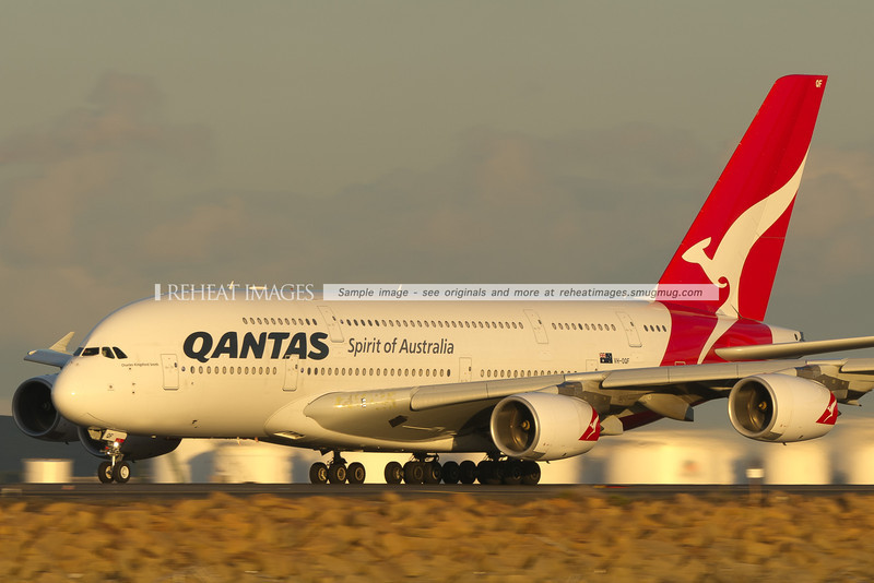 Qantas' A380-842 'Charles Kingsford Smith' is seen taking off from Sydney airport at sunset.
