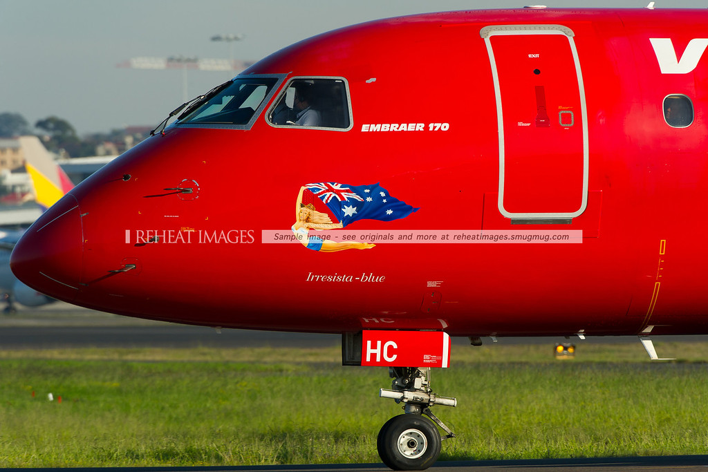 Virgin Blue Embraer E170 at Sydney airport. This one is called Irresista Blue