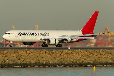 A Qantas Freight (Express Freighters Australia) Boeing 767-381F/ER lands at Sydney airport on runway 34 left.