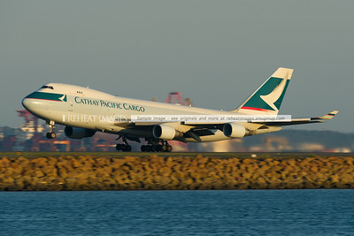 Cathay Pacific Cargo B747-467F/ER B-LID leaves Sydney at sunset.