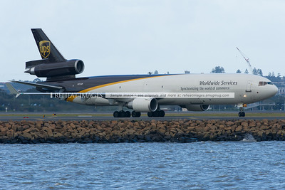 A United Parcel Service MD-11 has landed at Sydney Airport and is now turning to head to the freight area of the airport.
