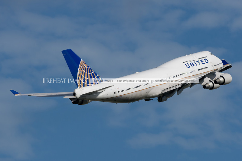 United Boeing 747-422 in the new colour scheme leaves Sydney airport headed for Melbourne.