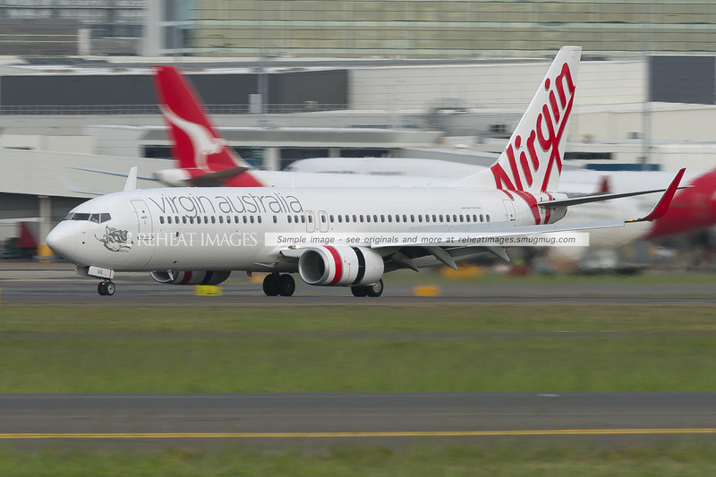 Virgin Australia B737-800 slows down after landing at Sydney airport.
