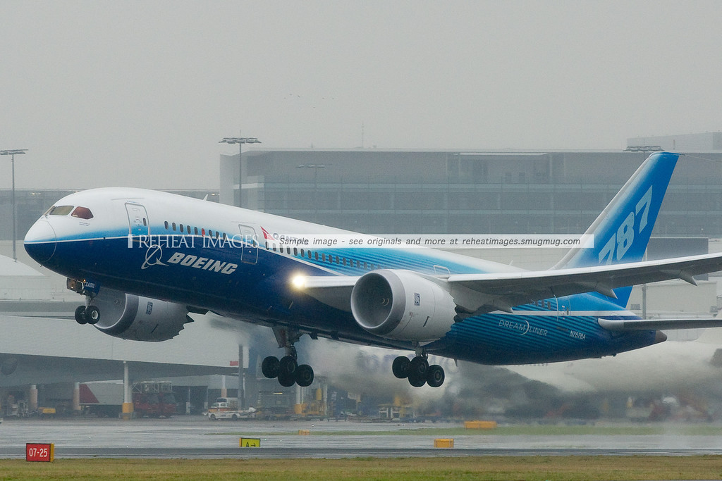 Boeing 787-8 Dreamliner Experimental takes off from Sydney Airport runway 16 right in very wet conditions.
