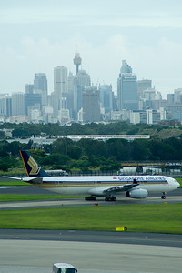 Singapore Airlines A330-300 waits for clearance to takeoff from runway 16 right. The plane is operating flight SQ242.