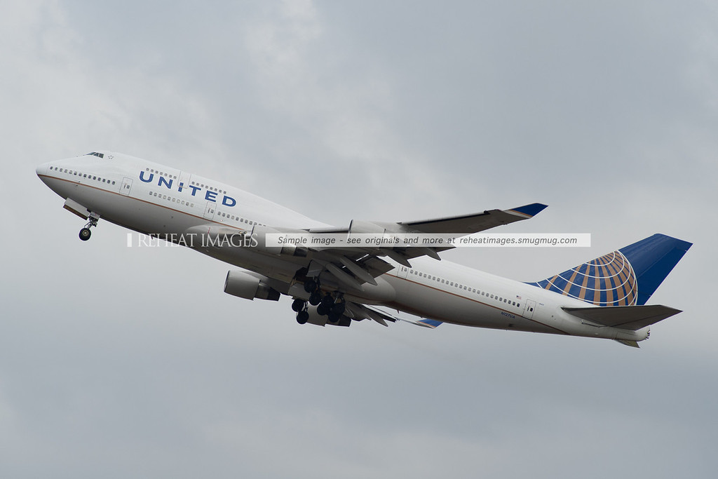 A United Boeing 747-422 in the new colours of the joint United/Continental airline leaves Sydney headed for Melbourne.