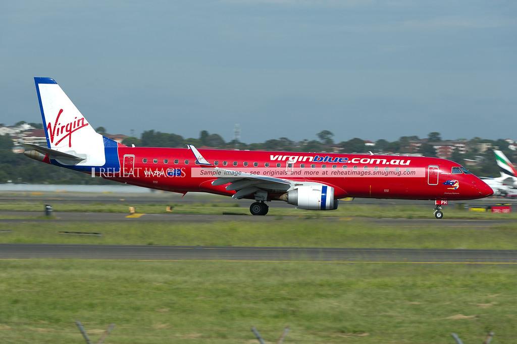 A Virgin Australia (Virgin Blue) Embraer E190 E-Jet arrives in Sydney airport.
