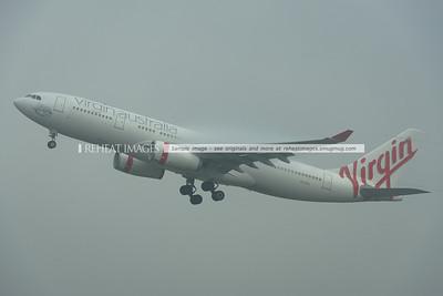 Virgin Australia Airbus A330-200 VH-XFA takes off from Sydney in heavy fog.
