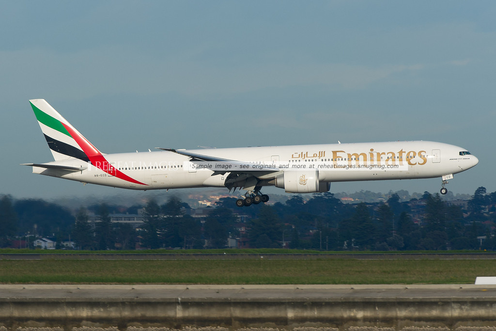 Emirates Boeing 777-300/ER is landing at Sydney airport runway 34 left.