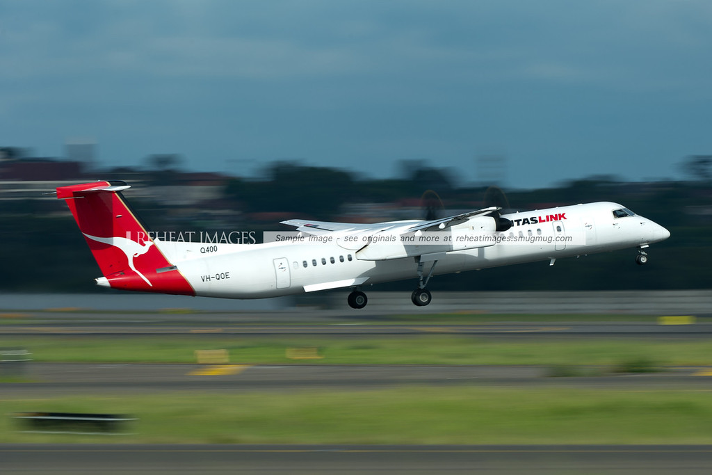 A QantasLink Bombardier Dash 8 Q400 leaves Sydney airport.