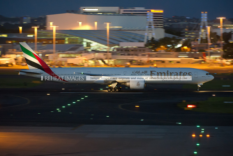 An Emirates Boeing 777-300/ER takes off from runway 16 right at Sydney airport.