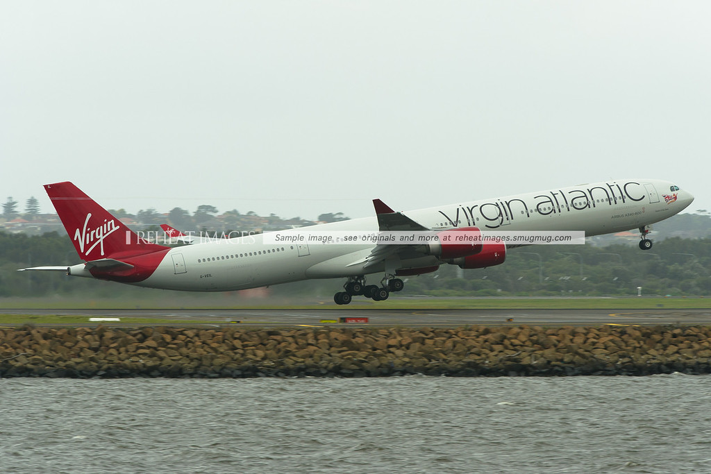 Virgin Atlantic A340-600 G-VEIL leaves Sydney in the new colours.
