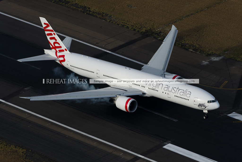 Virgin Australia B777-300ER landing at Sydney Airport, aerial view