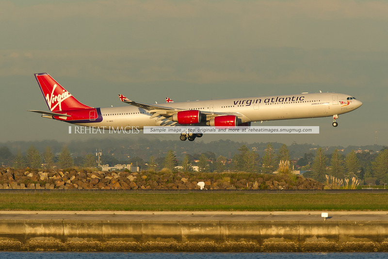 Virgin Atlantic A340-642 is landing at Sydney airport runway 34 left.
