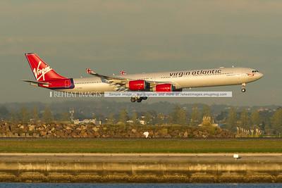 Virgin Atlantic A340-642 is landing at Sydney airport runway 34 left.