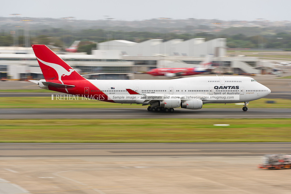 A Qantas Boeing 747-438 VH-OJP leaves Sydney airport on runway 16 right.