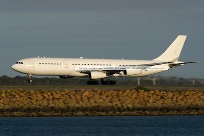 Adagold Aviation A340-300 CS-TQM leaves Sydney airport.