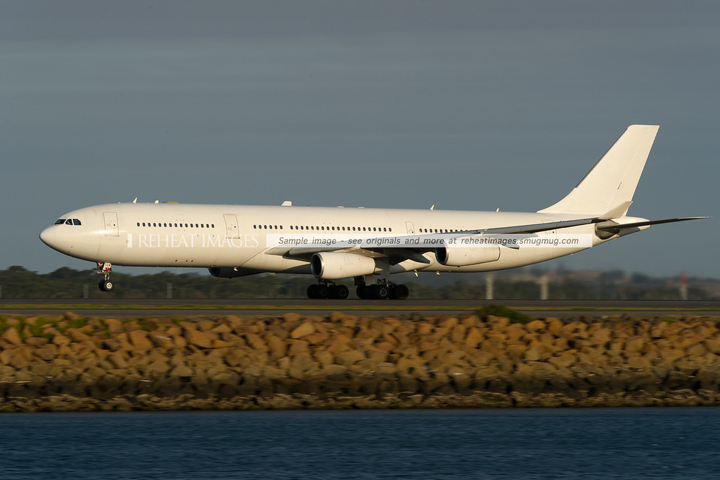Adagold Aviation A340-300 CS-TQM leaves Sydney airport.